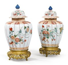 A pair of Chinese porcelain vases and covers, 18th century, with gilt-bronze mounts, late 19th century