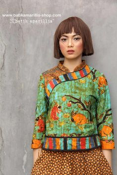 batik amarillis's joyluck jacket in handrawn batik wonogiren fauna  series Ethnic inspired outfit to bring you Joy & Luck.. beautiful reinvention of classic Qipao with exquisite detailing such as color combos,handmade chinese frog button,fittingly beautiful & it provides the ideal combination of style and comfort