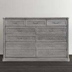 The Martinique 11 Drawer Dresser is a modern take on the transitional Director style. Available in two brushed satin walnut finished: Anchor Grey and French Grey, accented with polished Nickel hardware.