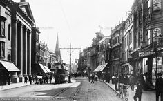 High Street, #Southampton, 1908. Following the Norman Conquest in 1066, Southampton became the major port of transit between the then capital of England, Winchester, and Normandy. Southampton Castle was built in the 12th century and by the 13th century Southampton had become a leading port, particularly involved in the import of French wine[19] in exchange for English cloth and wool. #history #photography #hampshire
