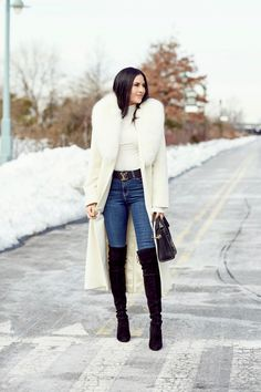 A white faux fur coat can be worn over anything! She paired it with jeans, a white top and over-the-knee boots: perfection! Winter Coat Outfits, Winter Fashion Outfits, Look Fashion, Autumn Winter Fashion, Fall Outfits, Womens Fashion, Cute Winter Coats, Petite Fashion, Classy Outfits