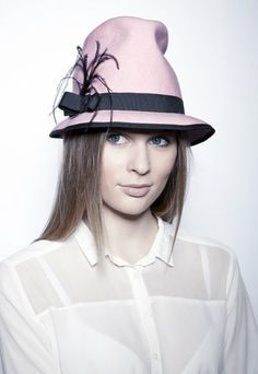 Calgary- less serious, feltring hat, light pink with a feather