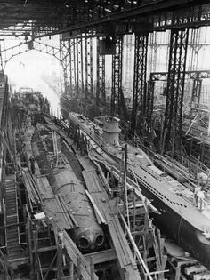 """German U-boat type VII-C during  construction at """"Blohm und Voss"""" shipyard in Hamburg, 1940. German sub construction never caught up with demand. As a result, the campaign to cut allied sea lines of communication failed."""