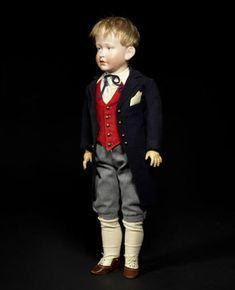 Antique Bisque Head Character Dolls - A Simon & Halbig 150 bisque head character boy doll. Sold for £22,500 (US$ 36,076). [Image courtesy of Bonhams www.bonhams.com]