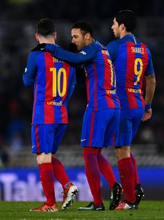 Neymar Jr. (C) of FC Barcelona celebrates with his team mates Lionel Messi and Luis Suarez of FC Barcelona after scoring from the penalty spot his team's first goal during the Copa del Rey quarter-final first leg match between Real Sociedad and FC Barcelona at Anoeta stadium on January 19, 2017 in San Sebastian, Spain.
