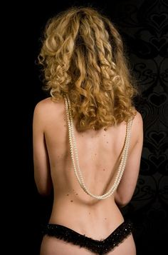 ;pearls on a naked back