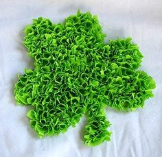 Tissue Paper Shamrock    Materials:  green construction paper, card stock or poster board  school glue or white craft glue  green tissue paper or party streamers  scissors