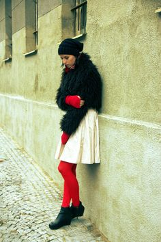 Bright red pantyhose matching fingerless gloves