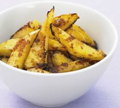 Roasted swede with Parmesan. Also called roasted rutabaga. We made both oven roasted and deep fried rutabaga fries, and served them with hamburgers and blue cheese. A great way to use up a rutabaga from your co-op or CSA! Bbc Good Food Recipes, Veggie Recipes, Healthy Recipes, Keto Recipes, Swede Recipes, Spiced Potato Wedges, Haggis Recipe, Lemon Roasted Chicken, Roasted Rutabaga