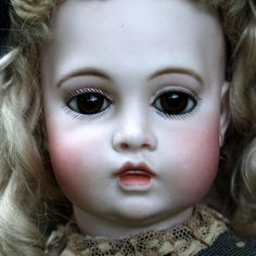 Offered on behalf of the Wood collection is this 20 Circle Dot Dream Bebe.  A magnificent transitional doll with the early  Bru body which dates this
