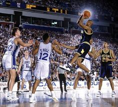 06 APR Jalen Rose of Michigan shoots a jumper over Antonio Lang of Duke during the Men's Final Four Championship held in Minneapolis, MN at the Humphrey Metrodome. Duke defeated Michigan to win the national title. Basketball Finals, Basketball Posters, Basketball Legends, Mario Chalmers, Ncaa Final Four, Michigan Wolverines Football, Fab Five, Michigan Wolverines