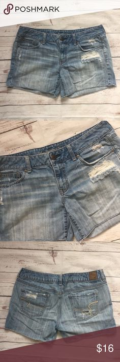 """-American Eagle- Distressed Cut Off Jean Shorts Women's Size - 12 Great pair of American Eagle Distressed Destroyed Denim Jean Shorts - shorts have a frayed, cut-off hem 100% Cotton Waist:  34"""" (laying flat) Inseam:  5""""  Rise: 8""""  Condition:  Shorts are distressed with holes, tears, frayed hem and fading as seen in photos  Please review pictures for product details.  Thank you for looking! American Eagle Outfitters Shorts Jean Shorts"""