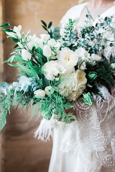 White Floral Bouquet With Foliage - 1920s Wedding Inspiration From Daisy Says I Do At Woodchester Mansion With White Green and Gold Colour Scheme And Images From Bowtie and Belle