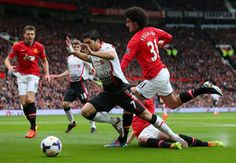 Luis Suárez goes down in the penalty area following a challenge by Phil Jones during the Barclays Premier League match between Manchester United and Liverpool at Old Trafford on March 16, 2014 in Manchester, England.