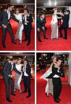 Liam Hemsworth, Jennifer Lawrence, & Josh Hutcherson at the Catching Fire World Premiere in London.