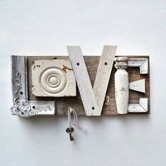 Upcycle old wood to make a handy sign to hold your keys. #reuse #recycle