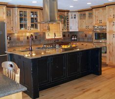 Modern Wooden Kitchen Cabinets Plus Chrome Metal Chimney Hood Above Distressed Kitchen Cabinets, Ready Made Kitchen Cabinets, Hickory Kitchen Cabinets, Kitchen Cabinets And Countertops, Kitchen Cabinet Design, Black Cabinets, Kitchen Paint, Pine Cabinets, Pine Kitchen