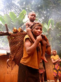 gabon- Baka woman holding her child