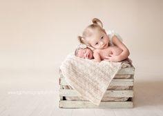 Posing newborns & siblings.