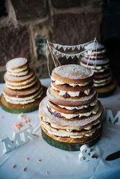 Three tier naked sponge cake. Photography by Kerry Woods.
