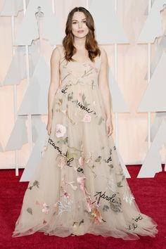 The mom-to-be works her signature romantic style in this floral appliqué couture gown by Valentino.   - HarpersBAZAAR.com
