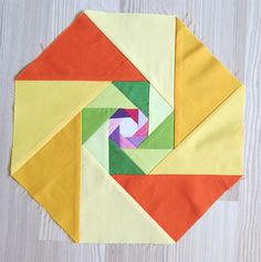 So I started with an1″ octagon. The result is also an octagon. I thought to apply the same geometry and I made a bigger block. …and bigger… …and bigger… Then I thought it is not big enough (30″) and it has too much green so I added one more triangle row (purple and pink). And …