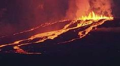 The Wolf volcano spews smoke and lava on Isabela Island