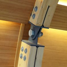 Pivoted steel connection between glue laminated rib components