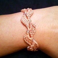 Thought you (mom) would like this  Crochet bracelet pattern (would make a nice variation of a ric-rac edging.)