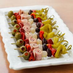 Muffuletta Skewers - salami, ham, and provolone rolls with olives, roasted peppers, pepperoncini; dress with Italian dressing