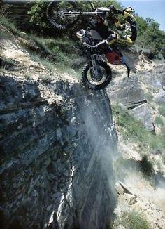 Cliff climbing on a dirt bike