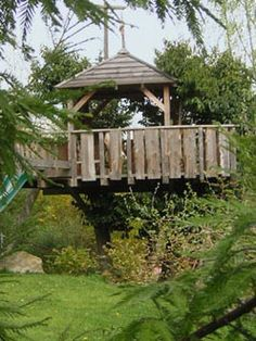 Seattle, WA  Summer 2004  This play fort built in a garden overlooks the beautiful Lake Washington. Built from reclaimed cedar, it has a ladder for the way up and a slide for the way down. No grown-ups allowed!