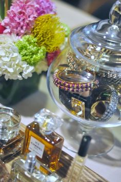 DIY Jewelery Organizer : use an Apothecary Jar as a pretty display for bangles.