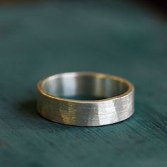 A 6mm silver wide band ring or him or her. Hammered textured band in recycled sterling silver.  This handmade artisan, wide, textured ring makes a