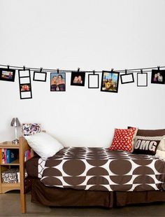 Use clothes lines to break up a wall and display art or notes in your college dorm room.