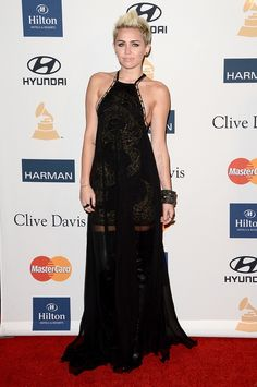 Miley Cyrus wears a daring Emilio Pucci gown at the Clive Davis & The Recording Academy 2013 Pre-Grammy Gala