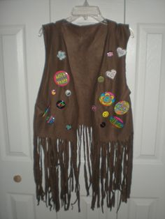I decided to be a hippie for Halloween this year but I couldn't find a vest with fringe.  My mom and I made this one out of a fleece throw.  They were two for six dollars and there was enough…