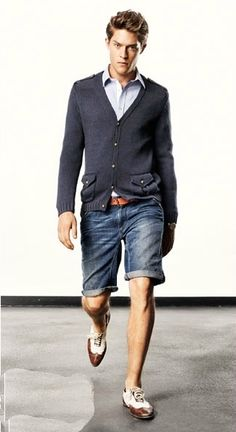 Drykorn - grey cardigan with epaulets, blue shirt, brown leather belt, cuffed Bermuda jean shorts, white and brown wingtip shoes