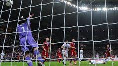 Cristiano Ronaldo (Portugal) & Petr Čech (Czech Republic)  Cristiano Ronaldo (R) of Portugal heads to score past Petr Čech of Czech Republic during their UEFA EURO 2012 quarter-final match
