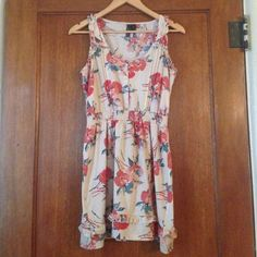 Cute floral dress! This adorable floral patterned dress has a great waistline and buttons up the breast area. It also has very small ruffles in the straps and the bottom of the dress. It has a water paint like floral pattern and is lightly used! The size says XL but it is more of an L. Tilly's Dresses Mini