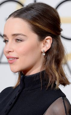 Emila Clarke from Best Beauty Looks at the 2016 Golden Globes With supermodels Gigi Hadid and Cara Delevingne sporting half-up styles, it was only a matter of time until the style worked its way onto the red carpet. Emilia Clarke strikes a casual-yet-sophisticated vibe with her bouffant on top, waves on bottom style that works just as well for red carpet as it would a day at the office.