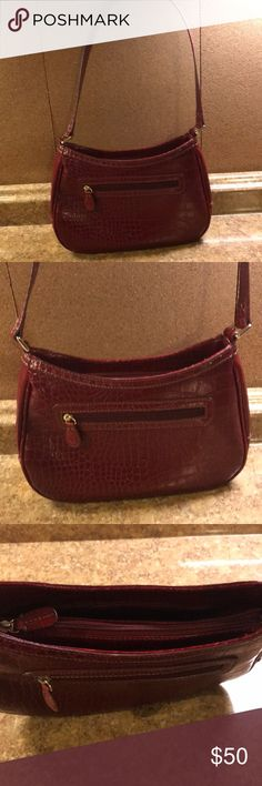 """Liz Claiborne Burgandy Python-style Leather Purse Dimensions are 11"""" x 7"""" x 3"""".  Straps are 12"""" from top of purse to shoulder.  This is in excellent condition with inner original Liz Claiborne tag but no price tags.  Lots of space and organization inside for a smaller over the shoulder purse.  I have matching shoes listed too if anyone is interested. 🙂 Liz Claiborne Bags Shoulder Bags"""