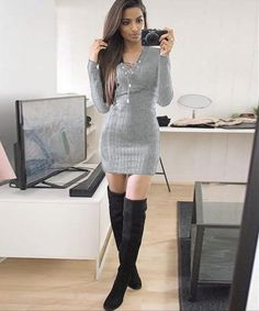 sexy secretary in a short skirt black tights and heels