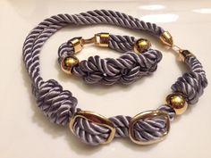 Collar y pulsera de cordón trenzado y piezas de Zamak. Materiales Farfalla
