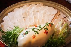 Finely decorated turkey, with cold slices for a meat buffet.