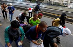 Venezuela opposition on the streets:     DEMONSTRATORS HOLD ROCKS AS THEY CLASH WITH THE RIOT POLICE DURING A RALLY IN CARACAS, VENEZUELA  Demonstrators hold rocks as they clash with the riot police during a rally.  -  April 10, 2017