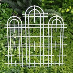 """Triple Trellis, White by Structures. $6.99. material: Metal. Color: White. size: 6.5"""" Wide x 7"""" High. A trellis is a functional structure often used to support plants, but a triple trellis goes beyond this definition. With its curved arches and straight lines, the triple trellis makes a statement in the garden by providing an interesting backdrop to your landscape. The trellis comes in a white or antiqued finish."""