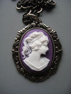 Purple Cameo Necklace in Silver by SilverTrumpet on Etsy, $20.00 I wish this was crazy large and could hang on a wall :)