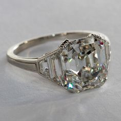 Beautiful Square Emerald Cut Diamond Ring | From a unique collection of vintage solitaire rings at http://www.1stdibs.com/jewelry/rings/solitaire-rings/