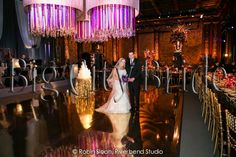 The couple takes a peak at their gorgeous wedding reception before guests enter! #bigcitybride #chicagowedding  #chicagoweddings #chicago #wedding #weddings #weddingplanner #weddingplanners #weddingday